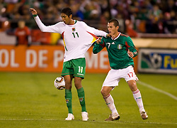 February 24, 2010; San Francisco, CA, USA;  Mexico defender Jorge Torres (17) tugs on the jersey of Bolivia midfielder Samuel Galindo (11) during the first half at Candlestick Park. Mexico defeated Bolivia 5-0.