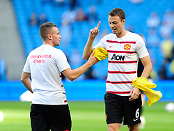 Manchester United's Tom Cleverley and Manchester United's Jonny Evans - Photo mandatory by-line: Dougie Allward/JMP - Tel: Mobile: 07966 386802 22/09/2013 - SPORT - FOOTBALL - City of Manchester Stadium - Manchester - Manchester City V Manchester United - Barclays Premier League
