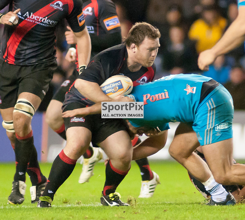 Alan Jacobsen is tackled by Gabriel Pizzaro,Edinburgh Rugby v Aironi, Rabodirect Pro12