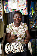 Esther Igwe in her shop 'Goshen Decorates', where she makes and sells decorations for parties and events, Nigeria.<br /> <br /> Esther attended a business training workshop with Youth for Technology and also signed up to receive the business support texts.<br /> <br /> She has learnt a lot from the course and the text messages; including business planning, capital investment, diversifying incomes streams and improving customer relationship management. She says profit is up 40% as a result, that her confidence has improved.<br /> <br /> Esther started her business in 2010 because she had given birth to twins and with her previous three children the family were struggling financially.