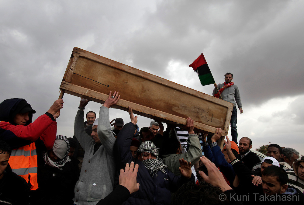 Casket of a victim of brutal crackdowns on protesters against Col. Muammar Gaddafi is carried at cemetery in Benghazi, Libya on Feb 25, 2011. Hundreds have died during the protest earlier this week before the opposition took control of the city..Photo by Kuni Takahashi