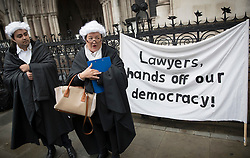 © Licensed to London News Pictures. 13/10/2016. London, UK. Protestors gather outside the High Court as a legal challenge is being launched, after the EU referendum result, to force the government to seek Parliamentary approval before Brexit negotiations begin. Photo credit: Peter Macdiarmid/LNP