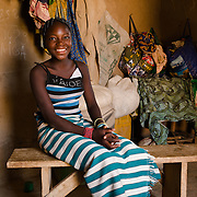 Rihanata Ouedraogo (15), pictured in Koala, Burkina Faso on 2 March 2014, spends over three hours a day fetching untreated water from a dam to meet the needs of herself and her large extended family. If she did not have to collect water, she says she would use the time saved to study.