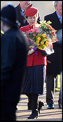 Princess Anne with flowers from the public after attending the Church service on the Sandringham estate with the Queen, Sandringham, Norfolk, United Kingdom. Sunday, 29th December 2013. Picture by Andrew Parsons / i-Images