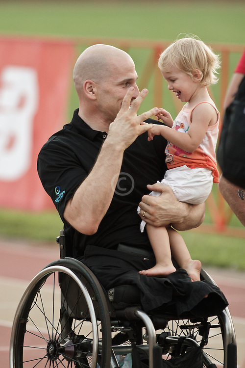 Falmouth Road Race: Falmouth Wheelchair Mile, Craig Blanchette with daughter