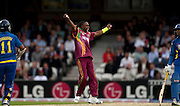 Dwayne Bravo celebrates having Kumar Sangakkara caught off his bowling during the ICC World Twenty20 Cup semi-final between Sri Lanka and West Indies at The Oval. Photo © Graham Morris (Tel: +44(0)20 8969 4192 Email: sales@cricketpix.com)