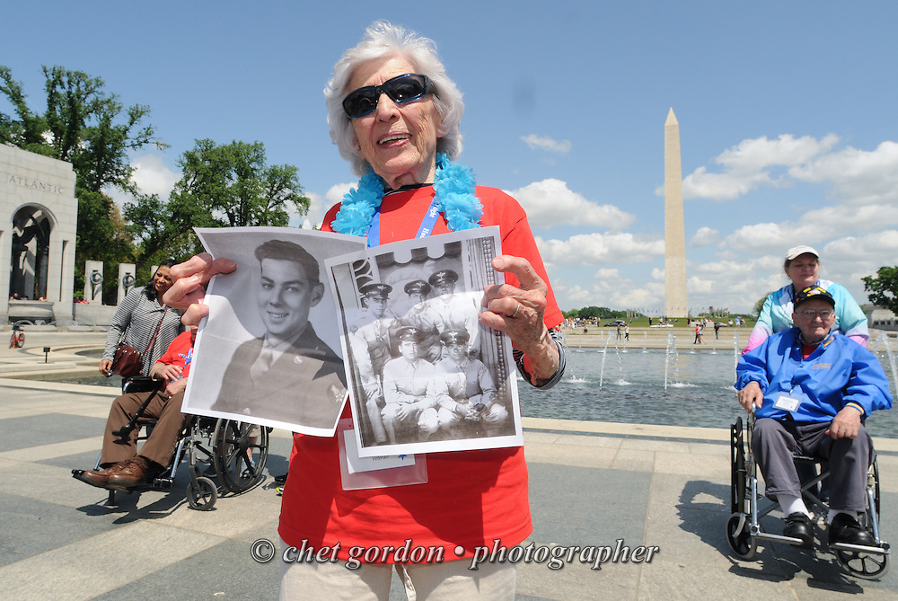 Mary Middleton of Cortlandt Manor, NY poses with photographs of fellow WWII Veterans she served with at the WWII Memorial in Washington, DC on Saturday, May 9, 2015. Middleton, an Army Air Corps WAC served in 1943 - 1944 at Dale Mabry Field as an air specialist in WWII. She joined Sixty-five other veterans from the Westchester County (NY) area toured the WWII and Marine Corps War Memorials, as well as Arlington National Cemetery. Hudson Valley Honor Flight is a chapter of the Honor Flight Network, which provides free flights for WWII Veterans and tours of the WWII Memorial constructed in their honor, and other sites in the nation's capital.  © Chet Gordon / Hudson Valley Honor Flight