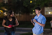 Addison Senter, a freshman majoring in Athletic Training from Hilliard, OH, and Robbie Harris, a freshman majoring in Astrophysics from Lancaster, OH, share a laugh while playing cornhole during the Late Night on the Green on Wednesday, June 3, 2015.  Photo by Ohio University  /  Rob Hardin