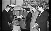 07/02/1964<br /> 02/07/1964<br /> 07 February 1964<br /> Tour of Brother International Factory at Santry, Co. Dublin. Included are Mr J. Duane (Arnotts); John Malone, Foreman;  Miss M. Connolly (Boyers); Mr E. Roche (Arnotts) and Mr C.J. Magian, (Sewing Machine Centre) in the Paint Shop.