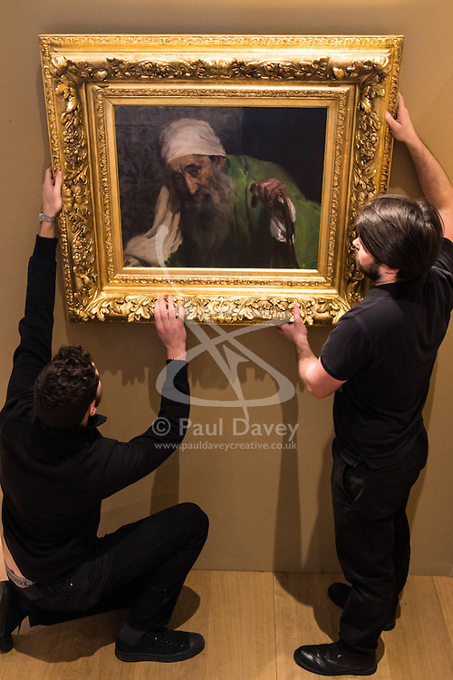 "Bonhams, Mayfair, London, February 26th 2016. Gallery technicians hang Joaquin Soralla y Basitda's ""Un Hebreo"", estimated to fetch between £300,000-500,000 which will be on display until the Bonhams 19th Century Art Sale in Mayfair, London on march 2nd 2016. ///FOR LICENCING CONTACT: paul@pauldaveycreative.co.uk TEL:+44 (0) 7966 016 296 or +44 (0) 20 8969 6875."