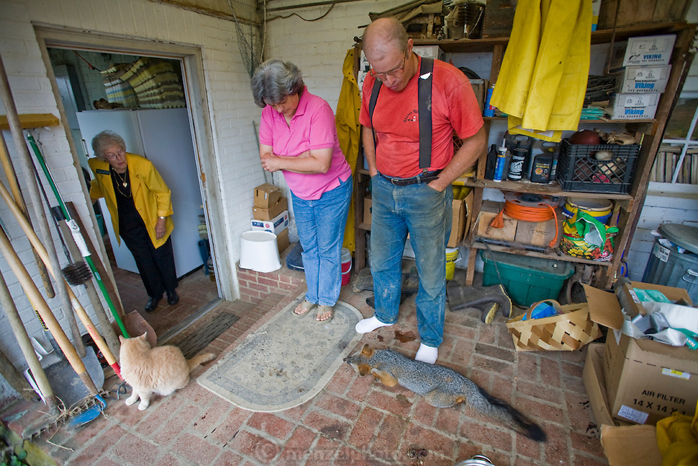 Farmer Joel Salatin and his wife show a dead fox to his mother at their farm in Virginia's Shenandoah Valley. (Joel Salatin is featured in the book What I Eat: Around the World in 80 Diets.)