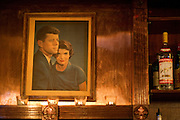 A portrait of John F. Kennedy and his wife Jacqueline hangs behind the bar at the Kennedy Room on Friday, January 18, 2013 in Dallas, Tx. (Cooper Neill/The Dallas Morning News)