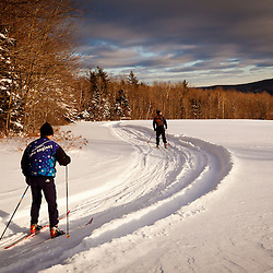 Two men cross country skiing at the Notchview Reservation in Windsor, Massachusetts. The Trustees of Reservations.