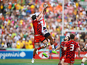 USA player Perry Baker wins the high ball during a restart in the game USA vs Wales during the Cathay Pacific/HSBC Hong Kong Sevens festival at the Hong Kong Stadium, So Kon Po, Hong Kong. on 7/04/2018. Picture by Ian  Muir.