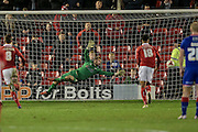 Sam Winnall (Barnsley) scores the penalty against Joel Coleman (Oldham Atheltic) to give Barnsley a 2-1 lead with about four minutes of 90 to go during the Sky Bet League 1 match between Barnsley and Oldham Athletic at Oakwell, Barnsley, England on 12 April 2016. Photo by Mark P Doherty.