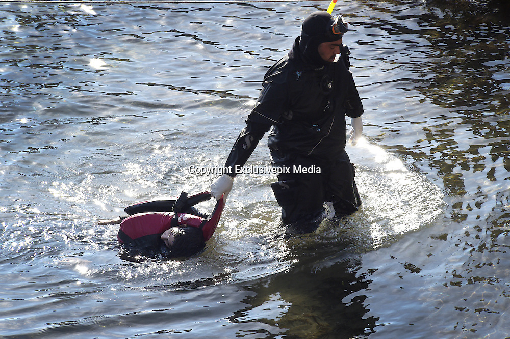 Oct. 15, 2015 - Lesbos Island, Greece - <br /> <br /> European Migrant Crisis<br /> <br /> A rescue diver drags a dead child from the water after a Greek Coast Guard vessel hit a migrant boat killing at least nine.<br /> ©Exclusivepix Media