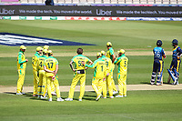 Cricket - 2019 ICC Cricket World Cup warm ups - Australia vs. Sri Lanka<br /> <br /> Kane Richardson of Australia gets a pat on the back from Usman Khawaja whilst waiting for the DRS decision on the dismissal of Dimuth Karunaratne of Sri Lanka during the cricket world cup warm up match at the Hampshire Bowl Southampton England<br /> <br /> COLORSPORT/SHAUN BOGGUST