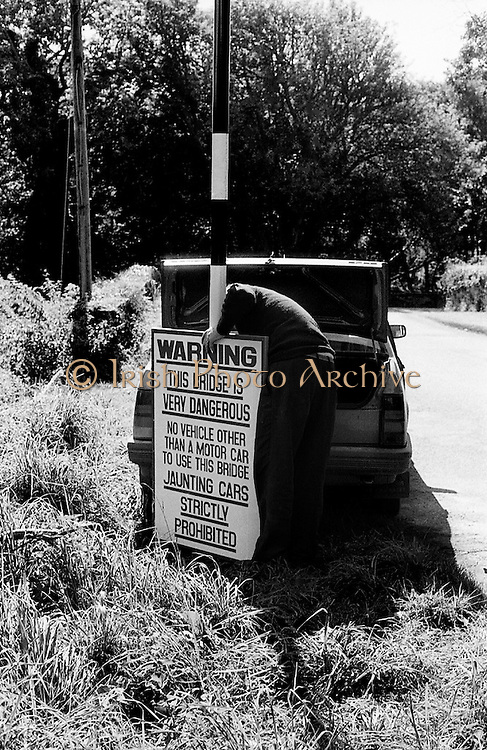 A sign is erected in Killarney, advising on the safety or otherwise of a bridge in the area.<br /> 2 September 1986