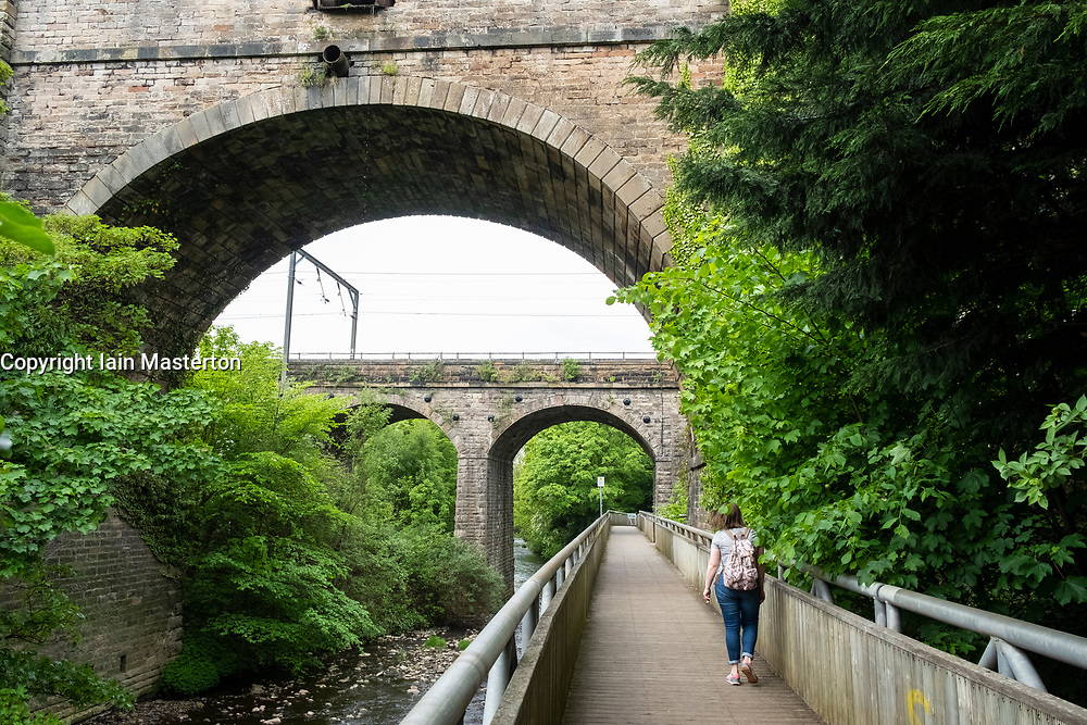 View of Water of Leith Walkway as it passes below aqueduct carrying the Union canal in Edinburgh, Scotland, United Kingdom, UK