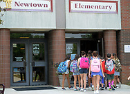 Students gather at the entrance as they arrive for the first day of school Tuesday September 5, 2017 at Newtown Elementary School in Newtown, Pennsylvania. (Photo by William Thomas Cain)