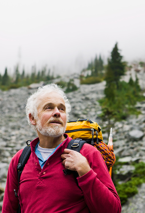 A portrait of a mature man out hiking in the mountains.