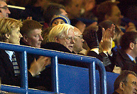 Photo. Jed Wee.<br /> Leeds United v Manchester United, Carling Cup, Elland Road, Leeds. 28/10/03.<br /> Leeds chairman Professor John McKenzie applauds the team as they go 1-0 up against bitter rivals Man Utd, even though things are far from comfortable off the pitch.
