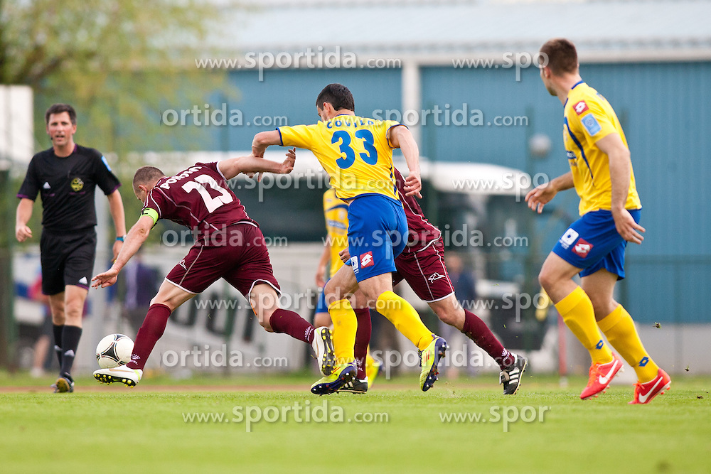 Jalen Pokorn of NK Triglav and Miroslav Covilo of FC Luka Koper during football match between NK Triglav and FC Luka Koper in 30th Round of Slovenian First League PrvaLiga NZS 2012/13 on April 28, 2013 in Sports park Kranj, Slovenia. (Photo by Grega Valancic / Sportida)