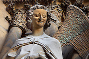 Angel Gabriel, annunciation group, right jamb statues of the central portal of the western facade of Notre-Dame de Reims (Our Lady of Rheims), pictured on February 15, 2009, 13th - 15th century, Roman Catholic Cathedral where the kings of France were crowned, Reims, Champagne-Ardenne, France.