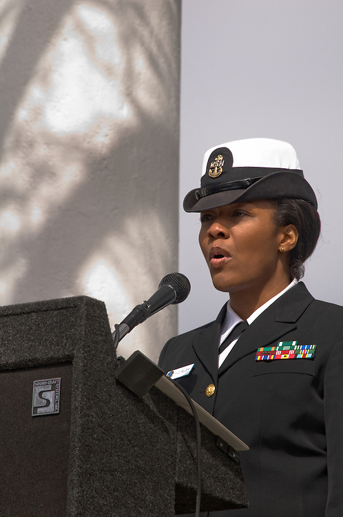 ARLINGTON, Virginia (March 28, 2011) -- U.S. Navy Musician Chief Petty Officer Yolanda Pelzer sings the national anthem during a remembrance ceremony at Arlington National Ceremony.  The event was held for family from around the country and for service members from all branches who gathered to honor 262 fallen medical service members who died in battle.  The Military Health System has hosted this event since 2009 and serves to bring families together who've lost loved ones that served as doctors, nurses, medics, corpsman and other medical personnel.  Photo by Johnny Bivera