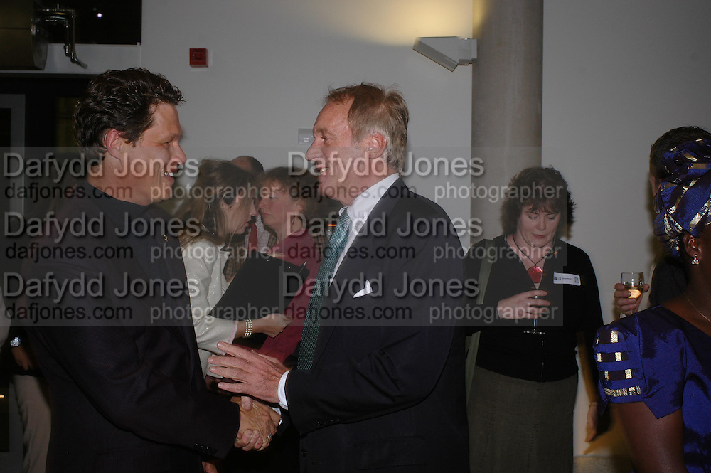 Will Travers and John Rendall. Cocktail party celebrating Born Free Foundation 21 years anniversary.  Royal Geographical Society, Kensington Gore. 14 march 2005. ONE TIME USE ONLY - DO NOT ARCHIVE  © Copyright Photograph by Dafydd Jones 66 Stockwell Park Rd. London SW9 0DA Tel 020 7733 0108 www.dafjones.com