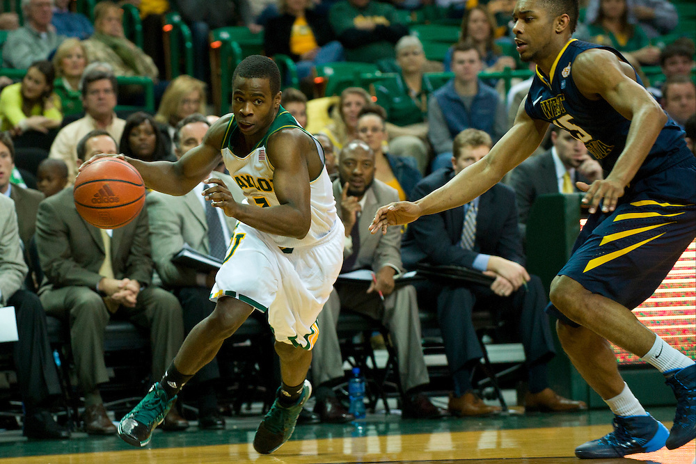 WACO, TX - JANUARY 28: Kenny Chery #1 of the Baylor Bears brings the ball up court against the West Virginia Mountaineers on January 28, 2014 at the Ferrell Center in Waco, Texas.  (Photo by Cooper Neill/Getty Images) *** Local Caption *** Kenny Chery