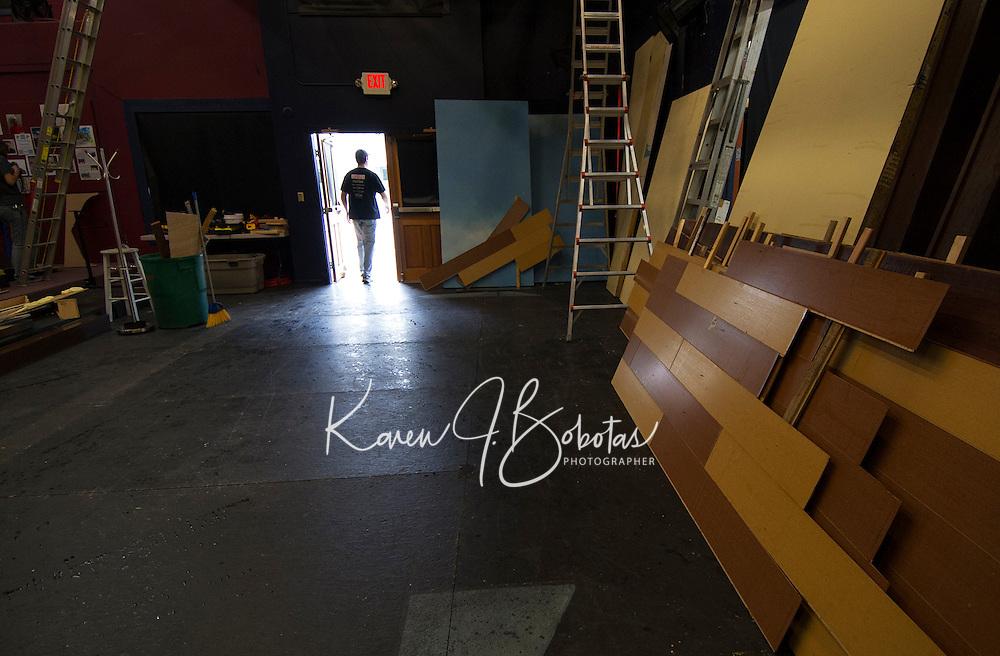 "Winnipesaukee Playhouse crew begins unloading pieces of flooring for the ""Night at Ballyhoo"" set on Sunday morning.  (Karen Bobotas/for the Laconia Daily Sun)"
