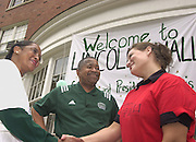 16596President McDavis greeting freshman students moving in Dorms visiting Lincoln Hall..Tricia O'Connor