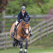 Molly Ashe riding Whistler in action during the $35,000 Grand Prix of North Salem presented by Karina Brez Jewelry during the Old Salem Farm Spring Horse Show, North Salem, New York, USA. 15th May 2015. Photo Tim Clayton