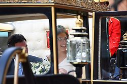 Princess Eugenie and her husband Jack Brooksbank travel in the Scottish State Coach at the start of their carriage procession following their wedding at St George's Chapel, Windsor Castle.