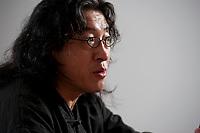 2010, BERLIN/GERMANY:<br /> Bei Ling (vollstaendiger Name Huáng Bèi Lǐng), chinesischer Schriftsteller, Poet, Essayist und Dissident, waehrend einem Interview, ehem. Stasi Gefaengnis und heutige Gedenkstaette Hohenschoenhausen<br /> IMAGE: 20101209-01-027