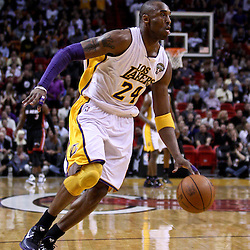 March 10, 2011; Miami, FL, USA; Los Angeles Lakers shooting guard Kobe Bryant (24) against the Miami Heat during the first quarter at the American Airlines Arena.  Mandatory Credit: Derick E. Hingle