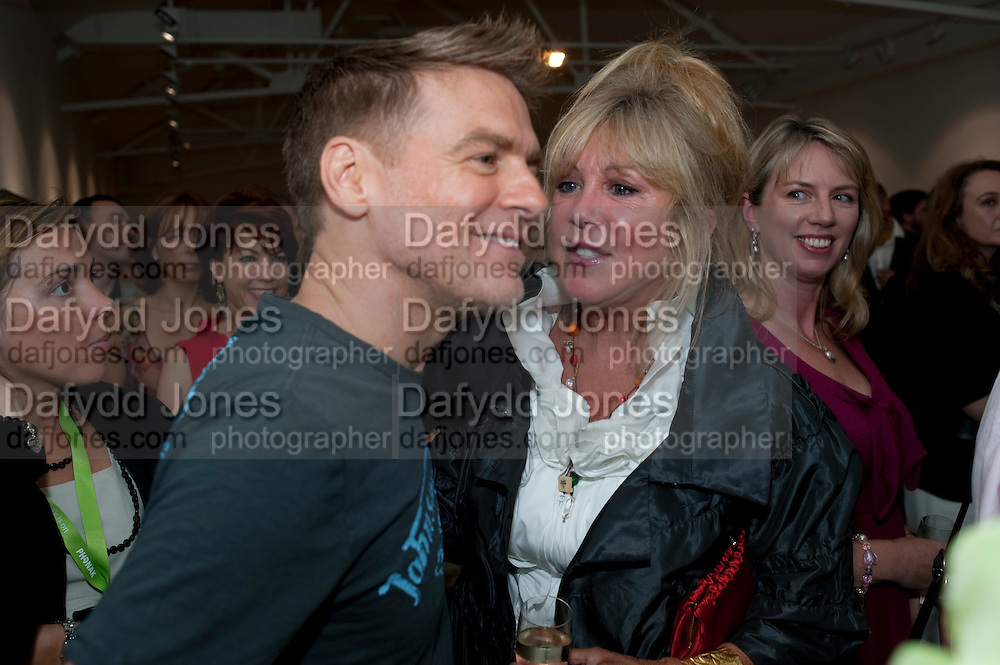 BRYAN ADAMS; PATTI BOYD, Hear the World Ambassadors Ð An Exhibition of Photography by Bryan Adams , The Saatchi Gallery. Sloane sq. London. 21 July 2009. Hear the World - an initiative by Phonak, aims to raise international awareness about hearing and hearing loss<br /> BRYAN ADAMS; PATTI BOYD, Hear the World Ambassadors ? An Exhibition of Photography by Bryan Adams , The Saatchi Gallery. Sloane sq. London. 21 July 2009. Hear the World - an initiative by Phonak, aims to raise international awareness about hearing and hearing loss