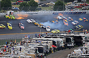 Apr 25, 2010; Talladega, AL, USA; NASCAR Nationwide Series driver Dennis Setzer (92) goes airborne into the catch fence as he crashes with Paul Menard (98), Brian Vickers (32), Justin Allgaier (12), Scott Wimmer (27), Eric McClure (24) and several others in turn four on the last lap during the Aarons 312 at the Talladega Superspeedway. Mandatory Credit: Mark J. Rebilas-US PRESSWIRE *** UK ONLY ***