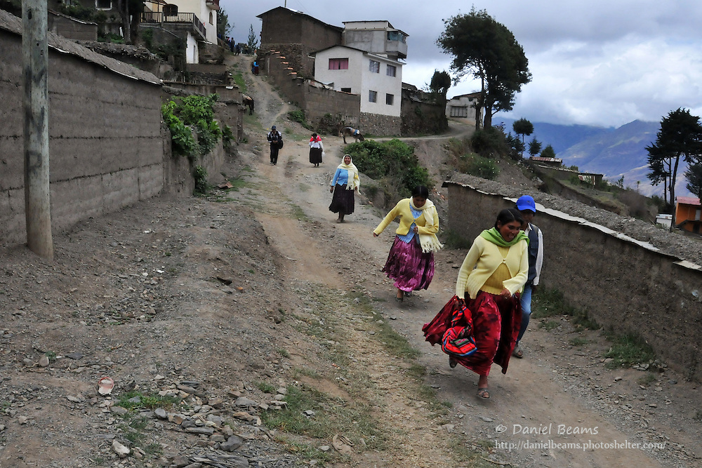 Girls running in Quiabaya, near Sorata, Bolivia