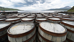View of whisky barrels at Bunnahabhain Distillery on island of Islay in Inner Hebrides of Scotland, UK