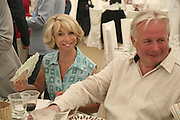 Helen Worth and Christopher Biggins, Cartier International Polo. Guards Polo Club. Windsor Great Park. 30 July 2006. ONE TIME USE ONLY - DO NOT ARCHIVE  © Copyright Photograph by Dafydd Jones 66 Stockwell Park Rd. London SW9 0DA Tel 020 7733 0108 www.dafjones.com