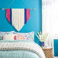 Knotted wall hanging in blue bedroom