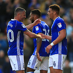 Birmingham City's Che Adams (right) celebrates scoring his side's third goal of the game against Crawley Town with Paul Robinson