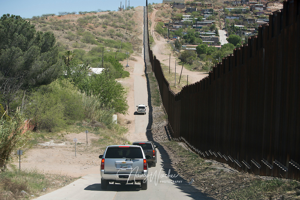 U.S. Border Patrol vehicles carrying representatives of the U.S. Conference of Catholic Bishops travel along the fence separating Mexico and the U.S. March 31 near Nogales, Ariz. A group of U.S. bishops made a two-day visit to the border region to celebrate a Mass, visit with migrants and renew their calls for  changes in the U.S. immigration system. (CNS photo/Nancy Wiechec) (April 1, 2014)  (CNS photo/Nancy Wiechec) (April 1, 2014)