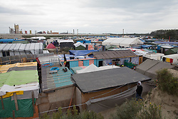 "Calais, Pas-de-Calais, France - 16.10.2016    <br />     <br />  ""Jungle"" refugee camp on the outskirts of the French city of Calais. Many thousands of migrants and refugees are waiting in some cases for years in the port city in the hope of being able to cross the English Channel to Britain. French authorities announced that they will shortly evict the camp where currently up to up to 10,000 people live.<br /> <br /> ""Jungle"" Fluechtlingscamp am Rande der franzoesischen Stadt Calais. Viele tausend Migranten und Fluechtlinge harren teilweise seit Jahren in der Hafenstadt aus in der Hoffnung den Aermelkanal nach Großbritannien ueberqueren zu koennen. Die franzoesischen Behoerden kuendigten an, dass sie das Camp, indem derzeit bis zu bis zu 10.000 Menschen leben Kürze raeumen werden. <br /> <br /> Photo: Bjoern Kietzmann"