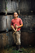 Portrait of vineyard worker holding horns for biodynamic farming  at Cooper Mountain Wine.