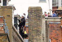 J11 protest.<br /> Specialist officers from the Metropolitan Police negotiate with protestors who have occupied a house in Beak St, Soho, during the J11 protest in central London by the StopG8 anti-capitalist movement,<br /> London, United Kingdom<br /> Tuesday, 11th June 2013<br /> Picture by Mark  Chappell / i-Images