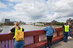 London, UK. 3 June, 2019. Five brightly-coloured banners bearing the slogans 'Resist Trump', 'Resist sexism', 'Resist racism', 'Resist hate' and 'Resist cruelty' are dropped on Vauxhall Bridge in view of the US embassy by activists from Amnesty International at the beginning of President Donald Trump's three-day state visit to the UK. Amnesty International has written to Prime Minister Theresa May has written to Theresa May to urge her to raise human rights issues directly with the US President.
