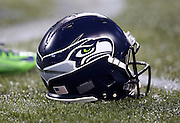 A Seattle Seahawks helmet lies on the turf during pregame warmups before the Seattle Seahawks NFL week 19 NFC Divisional Playoff football game against the Carolina Panthers on Saturday, Jan. 10, 2015 in Seattle. The Seahawks won the game 31-17. ©Paul Anthony Spinelli